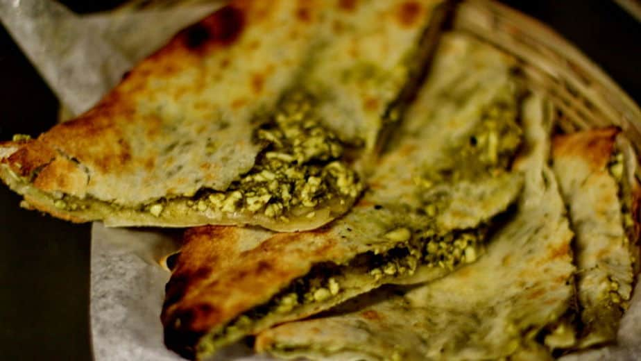 Imagine cottage cheese and finely chopped spinach sandwiched in between fluffy naan