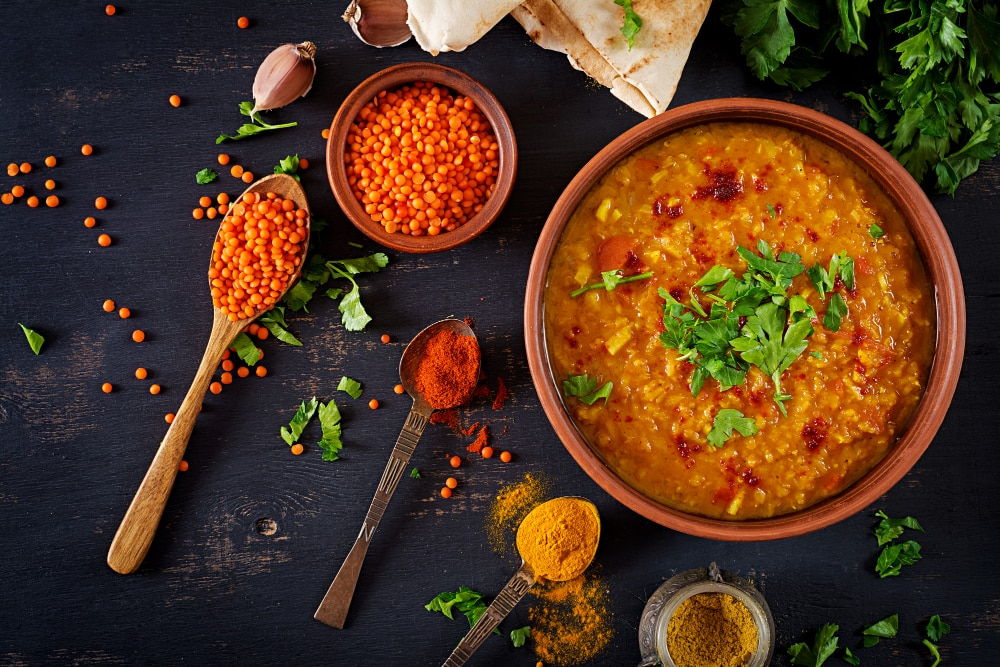 traditional-indian-soup-lentils-indian-dhal-spicy-curry-bowl-spices-herbs-rustic-black-wooden-table (1)